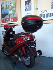 Scooter with crash bars and luggage and windshield