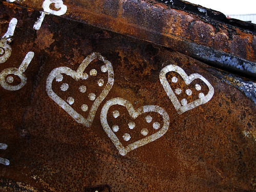 Silver hearts on rust by Eva the Weaver.