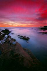 Skies ablaze (fischstarr) Tags: longexposure pink sea misty clouds sunrise dawn nikon rocks tripod sigma 1020mm manfrotto wollongong explored gradnd 121s cokinfilters 190xprob p154 d40x
