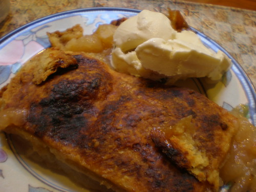 A piece of skillet apple pie with a scoop of HD Swiss Almond Vanilla ice cream