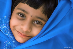 Smiling Blue (bnilesh) Tags: beautiful smile horizontal children asian happy kid innocent expressions