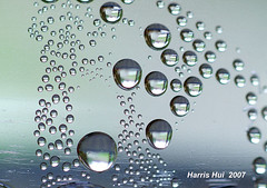 Water Drops 1130e (Harris Hui (in search of light)) Tags: canada macro reflection water beauty vancouver bc richmond waterdrops amateur waterdroplets mundane microlandscape macrolens macrophotography fujis3pro nikon105mmmacro beautyinthemundane worldofmacro beautyineveryday harrishui picturestakenwithtripod vancouverdslrshooter picturestakenathome reflectioninthewaterdrops waterdropsinthewaterbottle picturestakeninkitchen beautyintheordinaryobjects