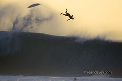 Randal Paulson surfing at Pipeline, north shore, Oahu, Hawaii, 01.19.06 (Sean Davey Photography) Tags: sunset color horizontal golden bigwave hugewave finephotographyart surfersphotographs imagessurf surfimage surfwipeout wipeoutimages wipeoutpic photographersfineart surfingpipelinenorthshoreoahuhawaiibigwavesrandalpaulsonwipeoutwipeoutsilhouettesseandavey
