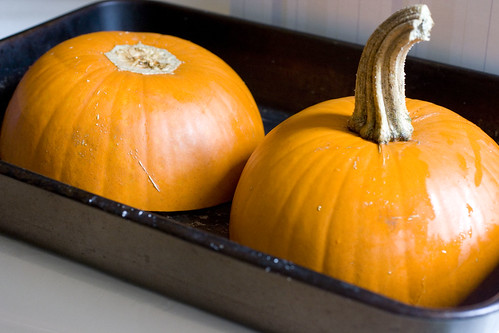 halved pumkins in a baking pan