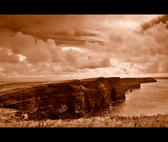 The Cliffs of Moher (5). Ireland.- (ancama_99(toni)) Tags: ocean county trip travel blue ireland sea vacation sky irish cliff paisajes naturaleza mer seascape green praia beach nature water monochrome rock sepia clouds marina photoshop vintage landscape geotagged island photography coast mar photo agua nikon marine rocks meer europa europe clare waves photos doolin wave photographic irland eire cliffs scenary layers cliffsofmoher paysage olas atlanticocean 2009 moher attraction irlanda irlande marinas countyclare d60 acantilados eireann republicofireland cliffofmoher 25favs 25faves holidaysvacanzeurlaub ancama99 7naturalwonders saariysqualitypictures new7naturalwonders
