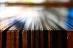 Weaving into bokeh (... Arjun) Tags: wood 15fav brown abstract black color colour macro art topf25 thread closeup 1025fav 510fav canon handicraft vanishingpoint asia dof bokeh 85mm 2550fav 500v50f 50100fav string cloth f18 laos weaving 2009 weave luangprabang loom skill indochina luangphrabang leadinglines luangphabang iso500 louangphrabang hbw bluelist canonef85mmf18usm bokehlicious laospdr unescoworldheritagecity canoneos5dmarkii 5dmarkii