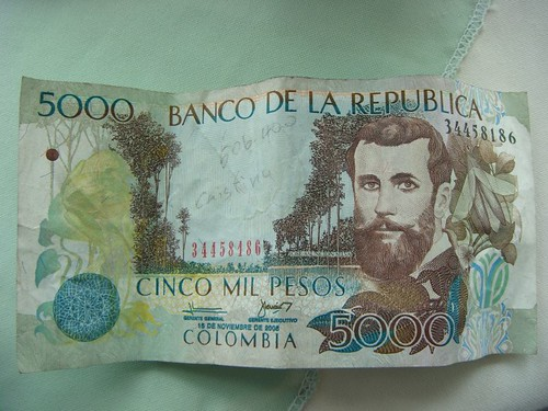 Colombian 5000 pesos note = 2.2 USD...