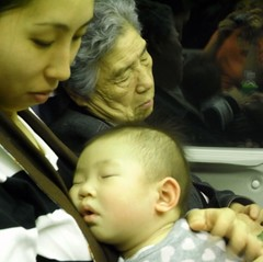 Shinkansen-sleep (Ginas Pics) Tags: people woman baby man color beautiful japan mom moving amazing colorful vivid nippon sos striking  shinkansen youngwoman extraordinary motherandchild bullettrain babysleeping 4generations youngmother momandchild artistpics beppusji grandmotherbabyand