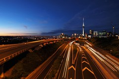 Auckland City at Dusk (timmelm) Tags: city longexposure blue sunset sky night lights motorway tripod clear auckland hero winner skytower lighttrails picnik aucklandharbourbridge