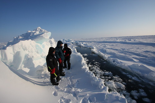 Sam Ratcliffe, Jim Ratcliffe and Chris Cecil Wright look for a crossing on the open water lead on the Arctic Ocean april 09 www.iceaxe.tv