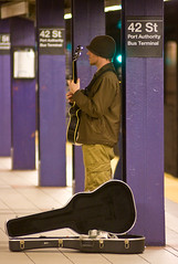 Urban Cowboy (TomBrooklyn) Tags: nyc ny beautiful subway purple metro guitar mta busker 2009 guitarist strummer 42ndstreet tombrooklyn