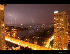 Lightning Strikes (Steve Rosset) Tags: ocean show city bridge pink light sunset sea wild sky urban panorama seascape canada storm west english nature electric skyline architecture night vancouver canon buildings landscape boats lights bay coast crazy dangerous long exposure downtown bc power skyscrapers purple traffic fireworks towers perspective apocalypse dream dramatic columbia special celebration event condo views highrise electricity imagine penthouse strike bolts british burrard lightning streaks drama luxury hsbc thunder condominiums active dreamscape 30d celebtation flickraward canadathunderstorms distinguishedsunrisesandsunsets tgamstormpics