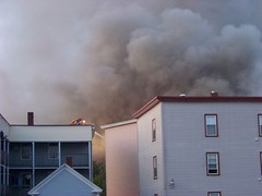 The smoke continues to pour out (Sam T (samm4mrox)) Tags: morning fire chaos smoke maine disaster damage unexpected firefighters lewiston disasters kodakz8612
