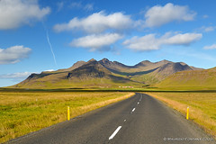 On the road 01 (Maurizio Fontana) Tags: road street travel blue light sunset sea sky orange color reflection fall water colors reflections d50 dark lights mirror fly waterfall iceland travels nikon strada tramo