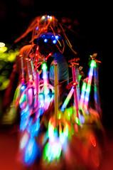 Alien Wares (pairadocs) Tags: street city light glass night lensbaby downtown neon glow michigan alien double led celebration grandrapids peddler sales seller composer wares