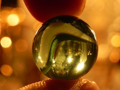 The World is Mine (Razvan F.) Tags: lighting color macro glass beautiful ball lights trapped nikon dof close bokeh fingers smooth round inside fingerprint p100 nikonp100
