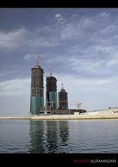 Progressing Bahrain (Murad Al Ramadan) Tags: sea sky urban skyline architecture modern skyscraper canon buildings bahrain construction gulf harbour crane capital towers middleeast progress structure arabia twisted gcc manama architectura bahrein bfh  villamar mywinners