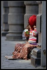 (piggy2007b) Tags: poverty street unicef brussels baby scarf hands shoes europa europe child belgium belgique belgie stones mother bruxelles skirt beggar kind desperate shops need bebe foulard maman rue gypsy brussel moeder handen rok kopftuch forlorn gipsy hopeless welfare straat winkels hoofddoek pilars vagabond zuilen stenen pauvret mendiant gitan pilaren armut gitane betteln bedelaar gueux bohemien verzweifelt trowsers mendier impoverishment wandarer