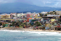 La Perla: Colorful slum of San Juan (StGrundy) Tags: ocean poverty travel cruise vacation tourism water colors architecture buildings nikon colorful waves tour bright oldsanjuan puertorico pastel shoreline overcast thepearl architectural sanjuan springbreak citywalls april caribbean 2008 picturesque ghetto viejosanjuan slum caribe celebritymillenium sanjuanpuertorico laperla lavida celebritycruises travelphotography sanjuanantiguo celebritycruiseline d80 callenorzagaray laperladelviejosanjuan thepearlofoldsanjuan