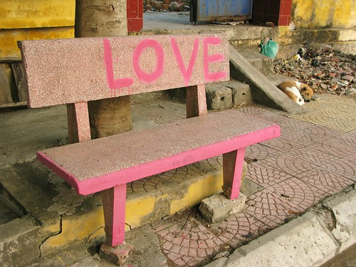 Love bench and napping dog, Cat Ba Island, Vietnam