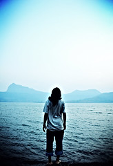 Staring at Nature's Blue Canvas (Silent Resilience) Tags: blue sea portrait sky lake mountains nature water beautiful painting landscape nikon rocks earth blues pebbles canvas shore ripples monday staring gazing enjoying farah theview wastingtime godscreation