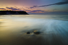 Runswick Bay; North Yorkshire (Corica) Tags: houses sunset seascape water landscape rocks waves yorkshire cliffs northsea runswick northyorkshire runswickbay corica dapagroupmeritaward