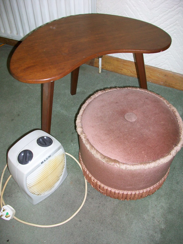 kidney shaped table, pink pouffee and electric fan heater 080