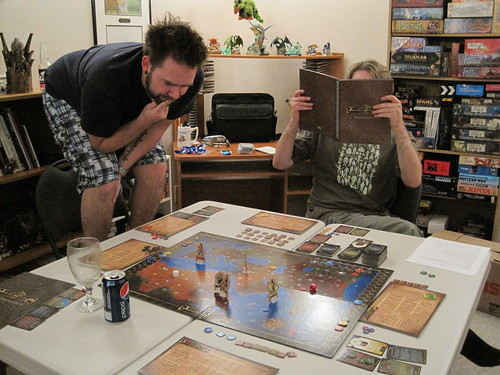 Planning my next move, while Scott reads from the games story guide