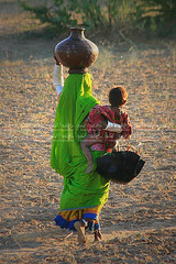 International Day of Rural Women on 15 October 2009 (Iqbal.Khatri) Tags: world life road travel pakistan portrait people woman water photography cow travels village desert shepherd walk traditional working hard places images ox east getty resolution 100 tradition care middle karachi 2009 sindh mithi thar generalassembly iqbal taker 15october khatri tharparkar canon400d 62136 iqbalkhatri ruralwomen travelingindesert firstinternationalday gettyimagespakistanq12012 gettyimagesmiddleeast