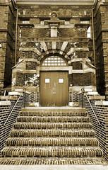 Ancient entrance... (tbower) Tags: ohio sepia architecture geotagged nikon jpeg d90 akronohio nrhp cs5 summitcountyohio nikkor1685 nikongp1 eclecticgermanmedieval frankbmeade
