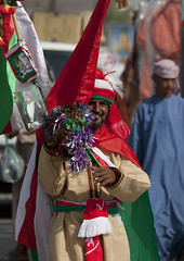 Omani fan with flags and Sultan's portrait for the Arabian Cup, Oman (Eric Lafforgue) Tags: people man color colour male tourism vertical fan football flag muslim arabic arabia peninsula oman ramadan couleur homme drapeau musulman omn dishdasha  omani arabie  colorpicture 8821 arabianpeninsula photocouleur sinaw om  omo umman omaan colourpicture claudeleroy   omanais   omna omanas umn