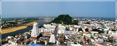 Kalahasthi Temple Town _ panorama (SenShots / Senthilmani's Photography) Tags: old bridge trees sky panorama india lake streets tower water canon buildings river way temple photography one town view god widescreen hill steps culture belief lord aerial divine sri trust strong tada tradition spiritual hindu hinduism andhra siva powerful 2009 tamil tamilnadu birdseye almighty southindia olden shivatemple gopuram oneness shivan telugu rahu southtemple ketu kalasthi templeindia indiantemples srikalahasthi andhratemple sthalam kalahasthi senshots armsenthil southindi senthilmani sivism swarnamookambigai swarnamakukhi senshotsphotography kalahathi srikalasthi