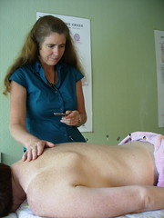 Charlotte Stuart treating a patient with  acupuncture moxibustion in Nelson, New Zealand (Wonderlane) Tags: newzealand people woman flow women energy with skin charlotte body traditional nelson stuart patient medical health needle restore points balance acupuncture unblock current along qi chinesemedicine humanbody pathways treatment specific licensed backpain alternativemedicine meridians stimulating stimulation treating moxibustion acupuncturist moxa  craniosacraltherapy heattherapy charlottestuart arternisiavulgaris needlemoxa orientalsystemofmedicine moekusa burningherb zhnju charlottestuartmacusarn stillpointacupuncture therapycraniosacral phone035457988 stillpointacupuncturecraniosacraltherapy certifiedcraniosacraltherapist photobyjaapbuijs jaapbuijsphoto charlottestuarttreatingapatientwithmoxibustioninnelson httpwwwstillpointacupunctureconz 114ahardystreet photobyjaapbuys jaapbuysphoto stillpointacupunctureandcraniosacraltherapy