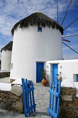 Thatched Roof Windmill Home, Mykonos, Greece 2008 (J K Johnson) Tags: door blue house color home windmill architecture interestingness interesting gate colorful published doors terracotta entrance style cruising architectural explore pot greece round unusual striking rockwall bluedoor mykonos thatched privateproperty roundhouse oceania bluegate stonewalkway jimjohnson thachedroof unusualhomes oceaniacruise jkjohnson thacthedroof meatemi