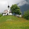 Maria Schnee Kapelle (NowJustNic) Tags: cloud mist flower tree church fog forest bench austria spring nikon day cross montafon hill meadow chapel dome kapelle vorarlberg d80 gaschurn nikkor18135mm