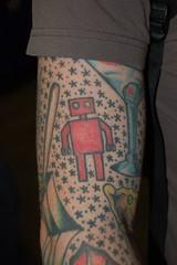 Wonder Con 2009: Red Robot Tattoo (earthdog) Tags: 15fav tattoo star robot arm bodyart 2009 unknownartist wondercon redrobot unknownperson armtattoo comicbookcon wondercon09 upcoming:event=1503135 upcoming:event=1633215 needscamera needslens