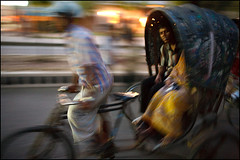 another speeding rickshaw - Chittagong (Maciej Dakowicz) Tags: city people urban blur speed asia ride traditional transport transportation passenger rickshaw bangladesh chittagong
