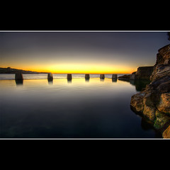 c o o g e e . p o o l (Pawel Papis Photography) Tags: ocean morning beach water yellow sunrise rocks sydney australia shore nsw newsouthwales rays tidalpool coogee coogeebeach smoothness 3xp sigma1020 goldish canon400d