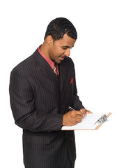 businessman - writing on clipboard (dgilder) Tags: people usa man male businessman writing austin person texas handsome business whitebackground africanamerican studioshot lookingdown survey questions isolated opinion stylish reviewing asking clipboard welldressed checklist questionnaire qualityassurance takingnotes isolatedonwhite midadultmen