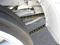 Chain drive:  Each rear wheel has it's own chain: 1912 Mack Bus (Bob_ Perry) Tags: julian sandiego antiquecar campo oldtruck oldbus macktruck horselesscarriage julianca juliancalifornia stageline antiquevehicle oldstage antiquebus oldmailtruck restoredbus restoredtruck juliancalif 1912mack mackbus julianoldbus campomotortransportmuseum campomuseum