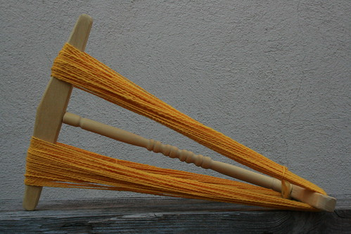 Handturned niddy noddie out of yellowheart wood.