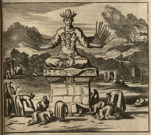 many-armed deity atop pedestal