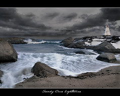 Sandy Cove Lighthouse (Dave the Haligonian) Tags: ocean sea sky bw canada beach water clouds bay blackwhite sand rocks novascotia atlantic atlanticocean sandycove maritme terencebay martime prospectbay sandycovelighthouse dsc6310jpg vosplusbellesphotos