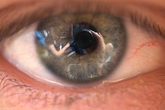 My eye, reflecting my camera and my girlfriend