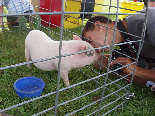 smooching with Bedazzled, the pig.
