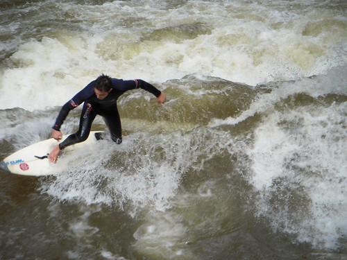 Locals ride the waves in Munich.