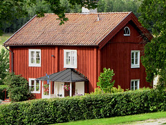Red Painted Wooden House in Sweden (Olof S) Tags: red summer wallpaper chimney sky house building tree verde green rot window architecture canon tile photography is photo wooden interesting arquitectura scenery europe view sweden fenster schweden edificio cottage picture haus swedish powershot nordic birch sverige furnace scandinavia altstadt btiment gebude hus suede suecia fenetre stuga srmland senso svezia szwecja falu sdermanland byggnad floda rdfrg sx10