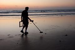 Treasure Hunter (San Diego Shooter) Tags: sandiego streetphotography metaldetector treasurehunter sandiegopeople sandiegostreetphotography manwithmetaldetector metaldetectorsilhouette