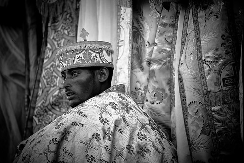 priest celebrates the festival Hosanna (Palm Sunday) in Axum. etiopia by ronnyreportage