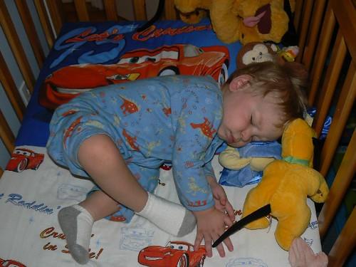 Happy sleeping boy in his CRIB